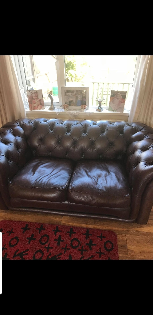 2x 2seater leather Chesterfield sofas and matching footstool