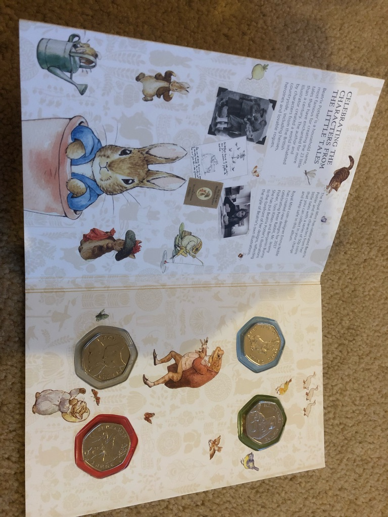 Beatrix potter 2017 book with all 4 coins