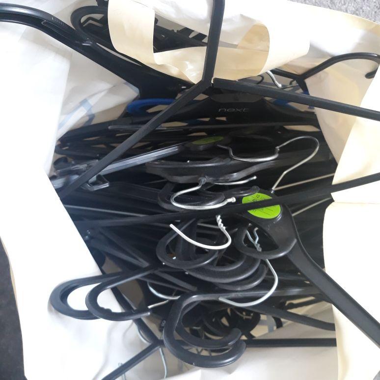 Black plastic assorted coat hangers
