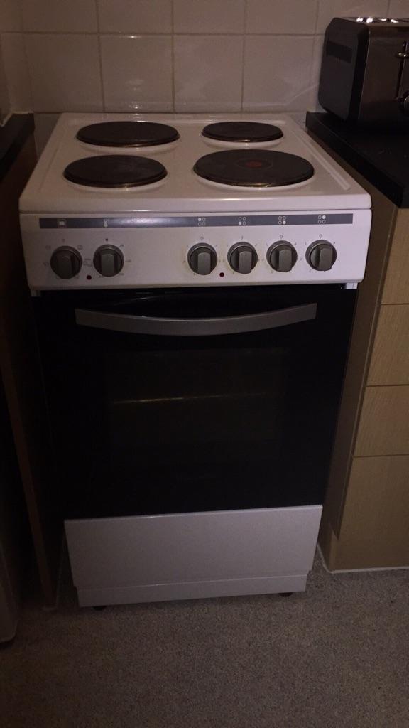 Cooker and small fridge freezer