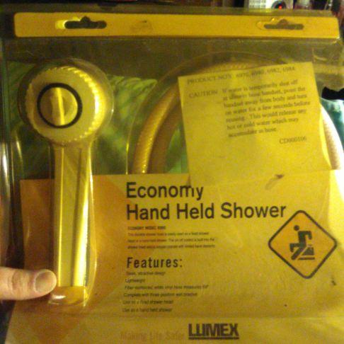 Economy hand held shower