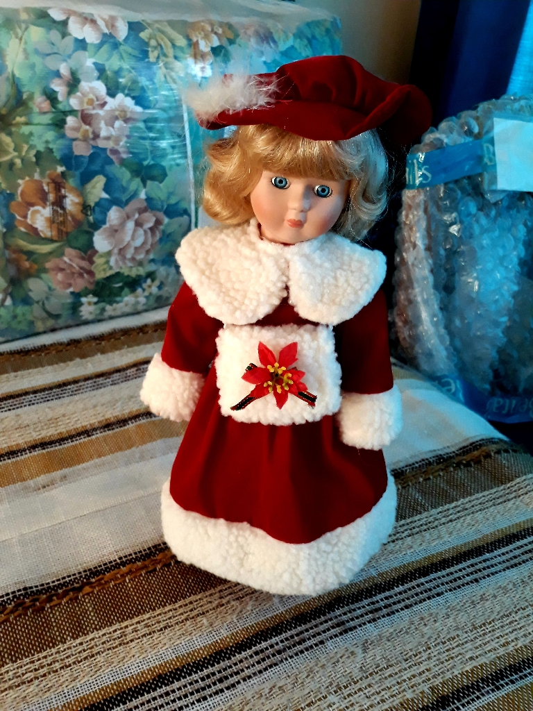 A Christmas doll on a stand