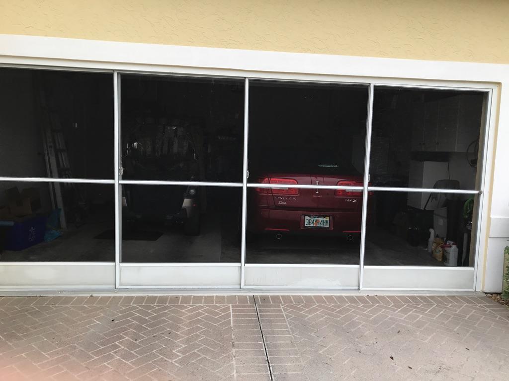 Sliding screen garage door