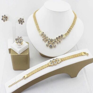 Diamond and gold plated necklace, ring, earrings, and bracelet set