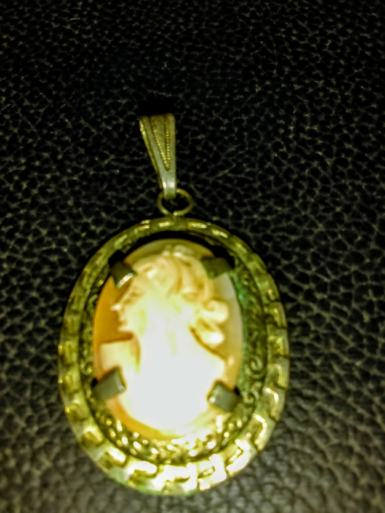 Antique hand carved cameo pendant