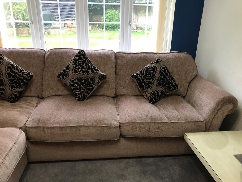 Luxor corner sofa and classic black cushions