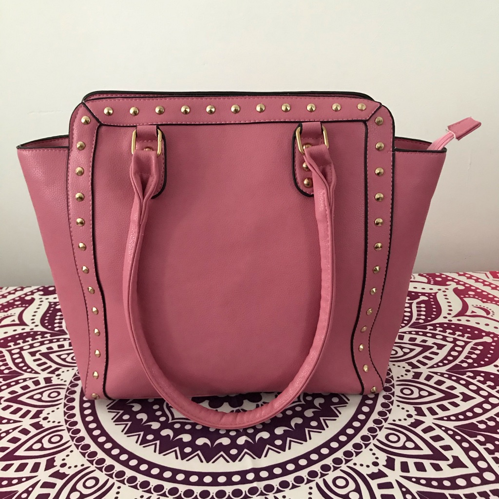 Light pink bag with gold studs