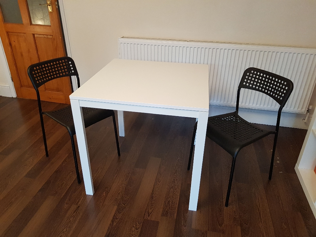 Small dinner table with chairs