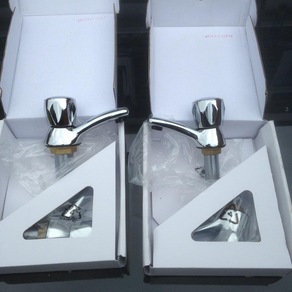 Chrome bath and hand basin taps