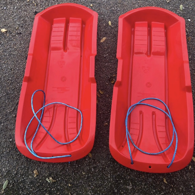 Pair of pull along sleds