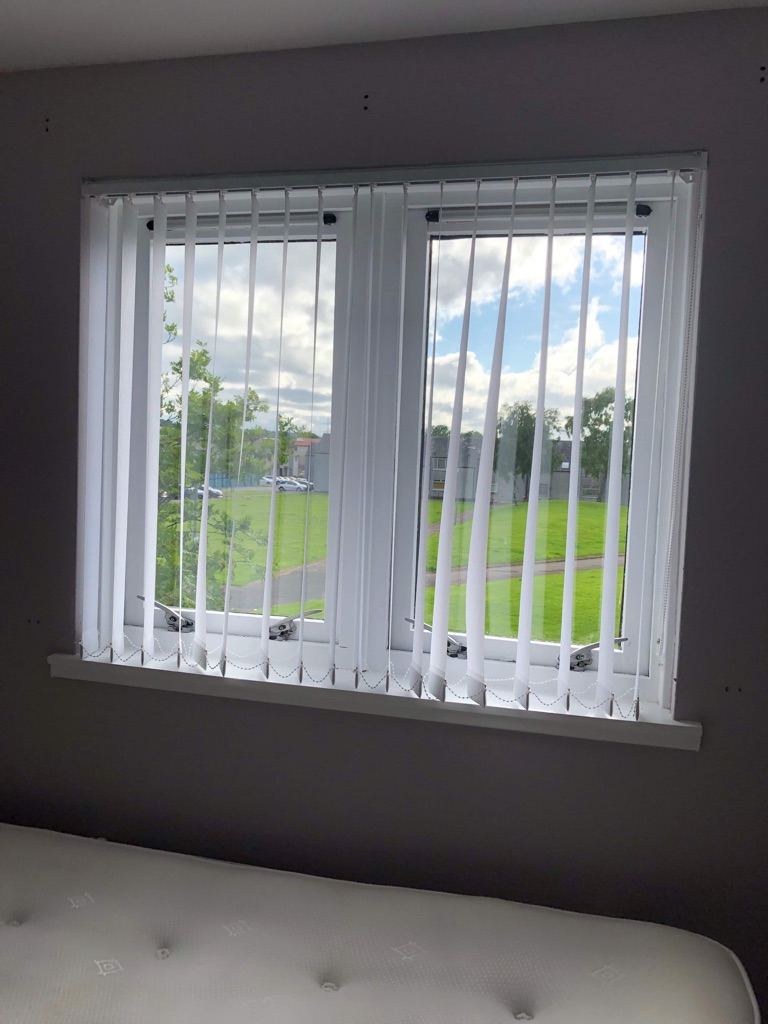 White vertical blinds and 1 grey roller blind 3 months old