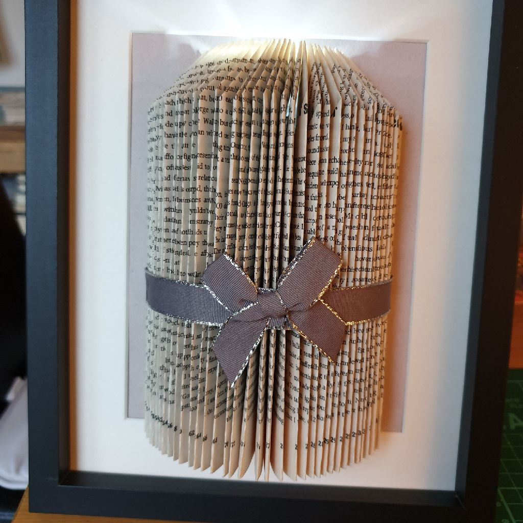 Book folded candle in frame
