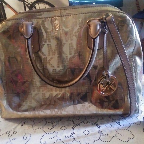 MK gold metallic purse