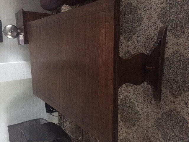 Solid dark wood extendable table