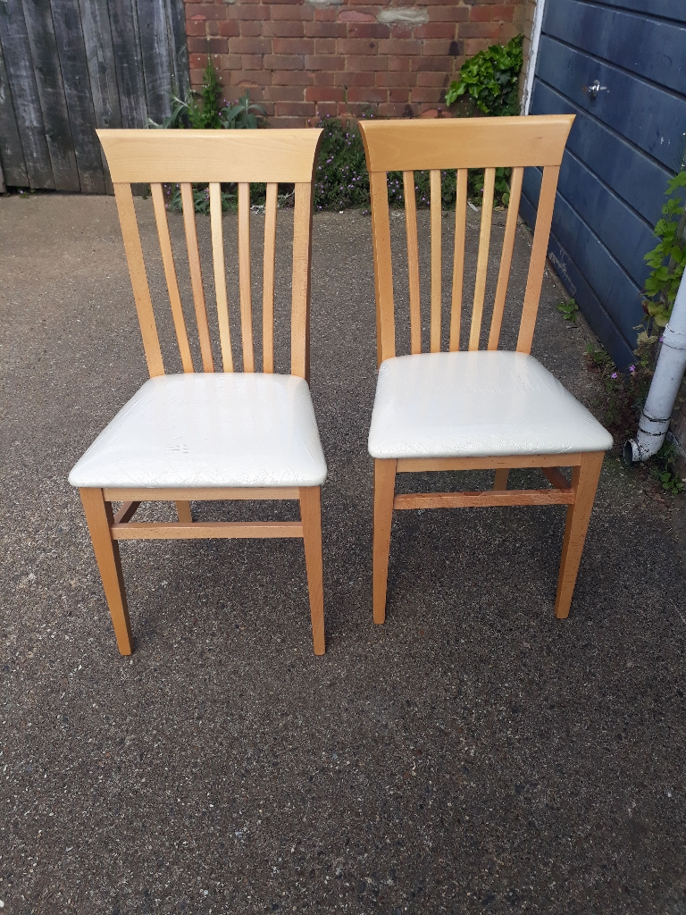Two beech dining chairs