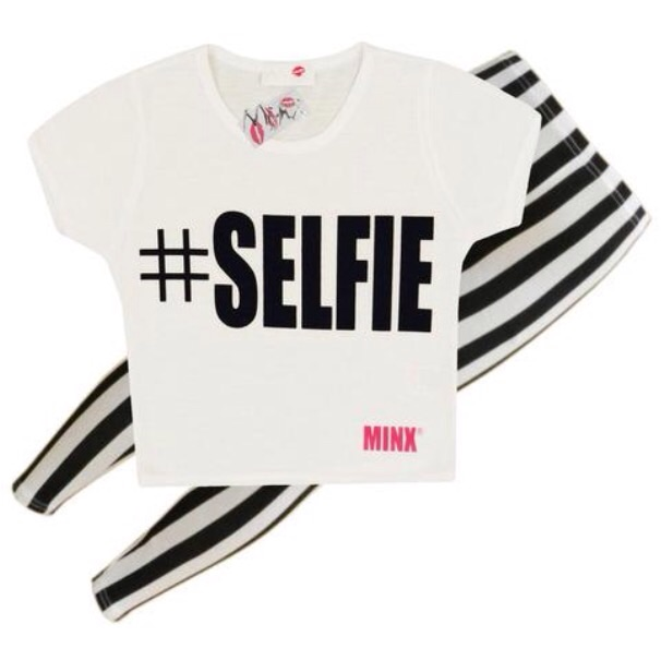 Girls selfie white crop top and stripe leggings