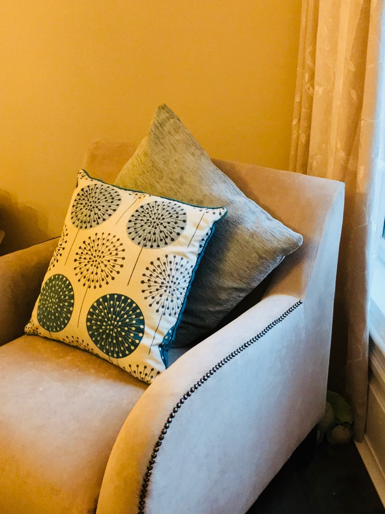 Comfy chair with pillows and studded