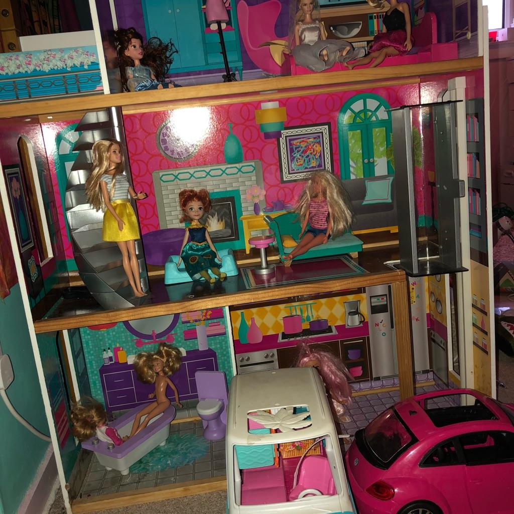 Barbie castle, camper van, car, furniture and barbies