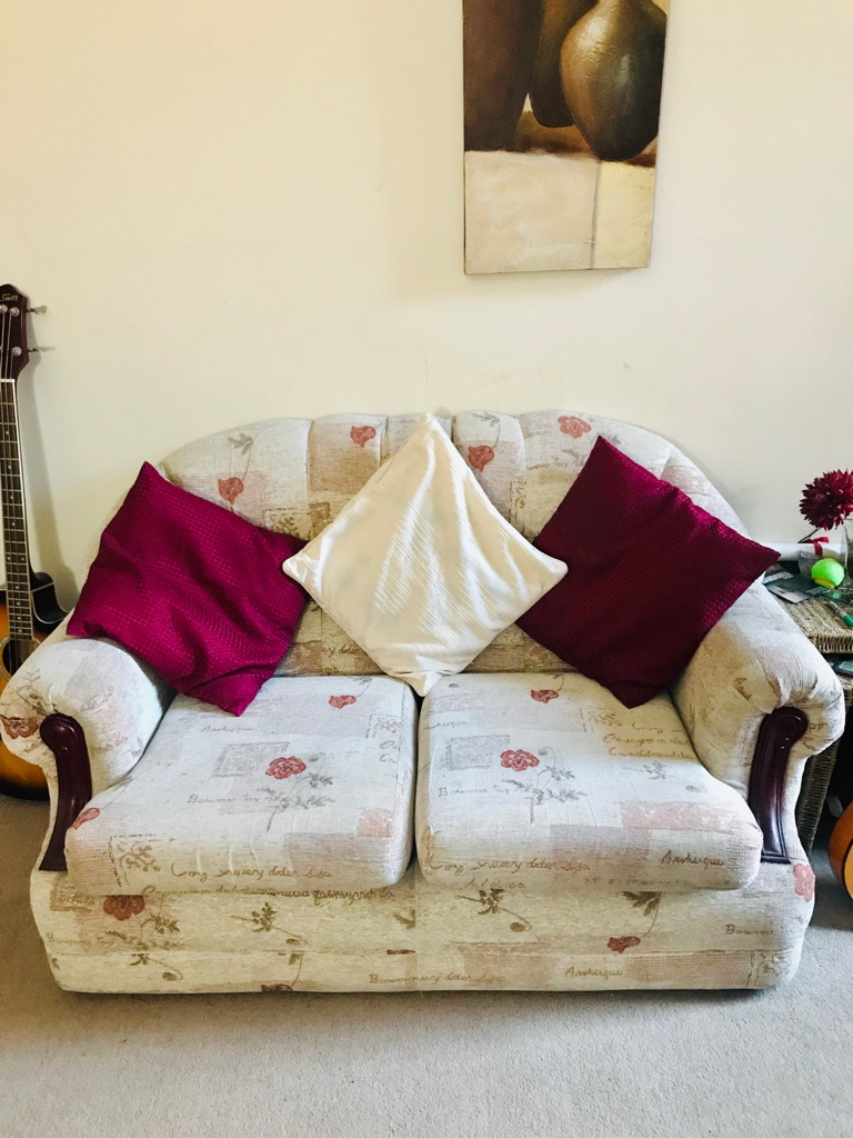 Red, cream and white sofa and matching chair - small. Great condition.