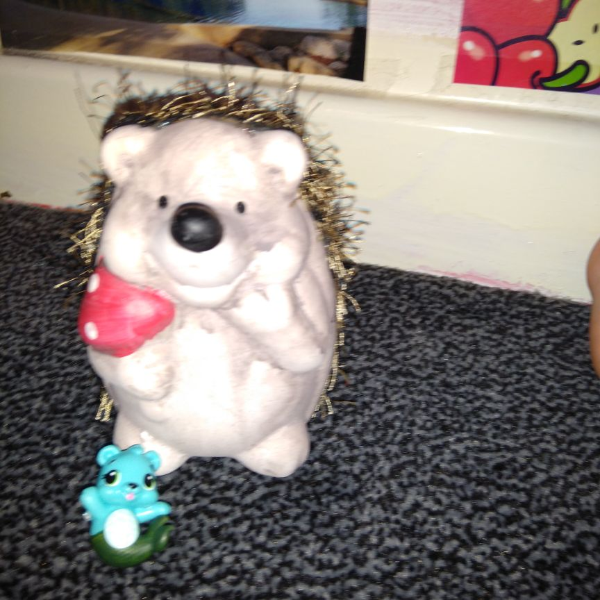 Hedgehog ornament and hatchimals toy