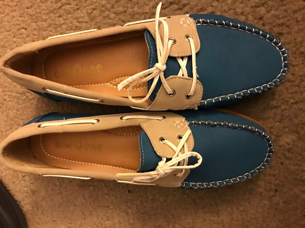 women blue tan and white shoes