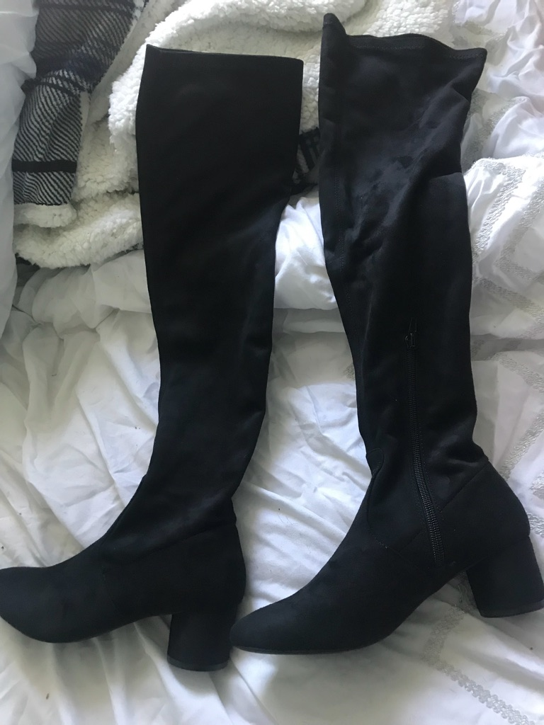 Knee length black boots