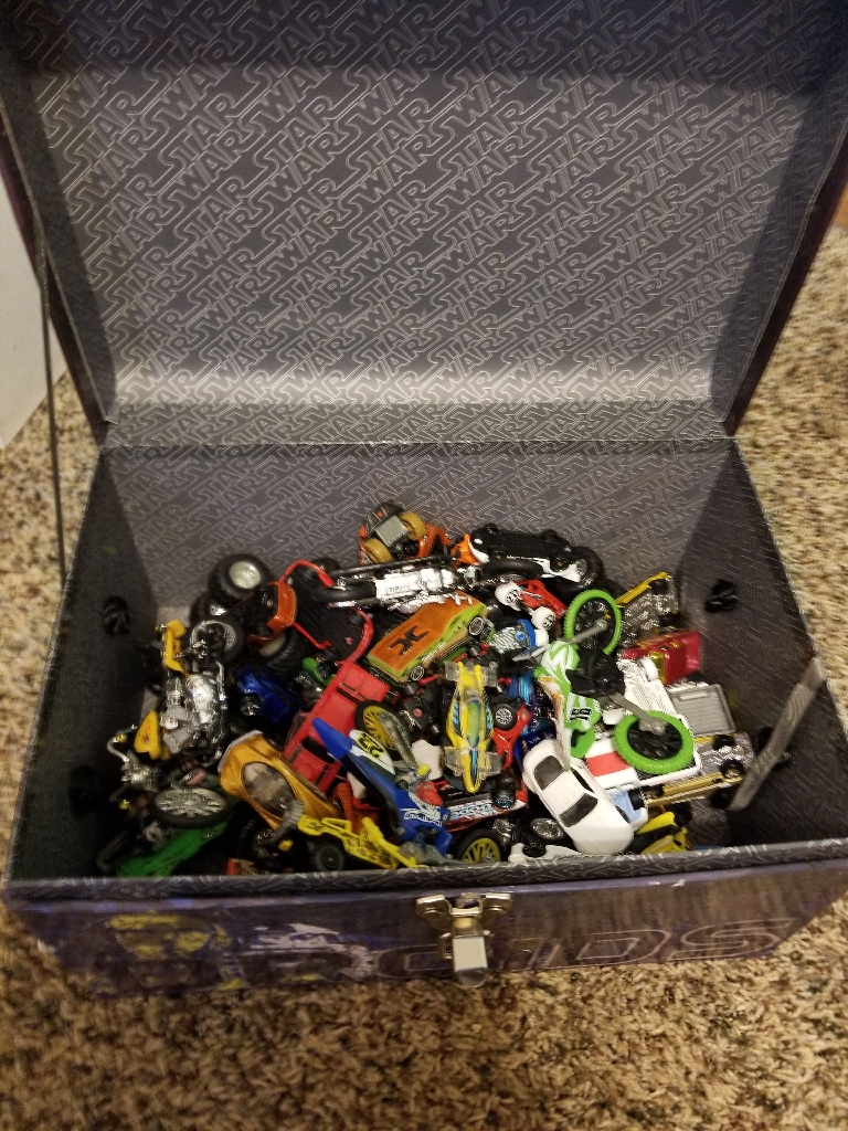 Star Wars toy chest filled with 71 different toy vehicles.