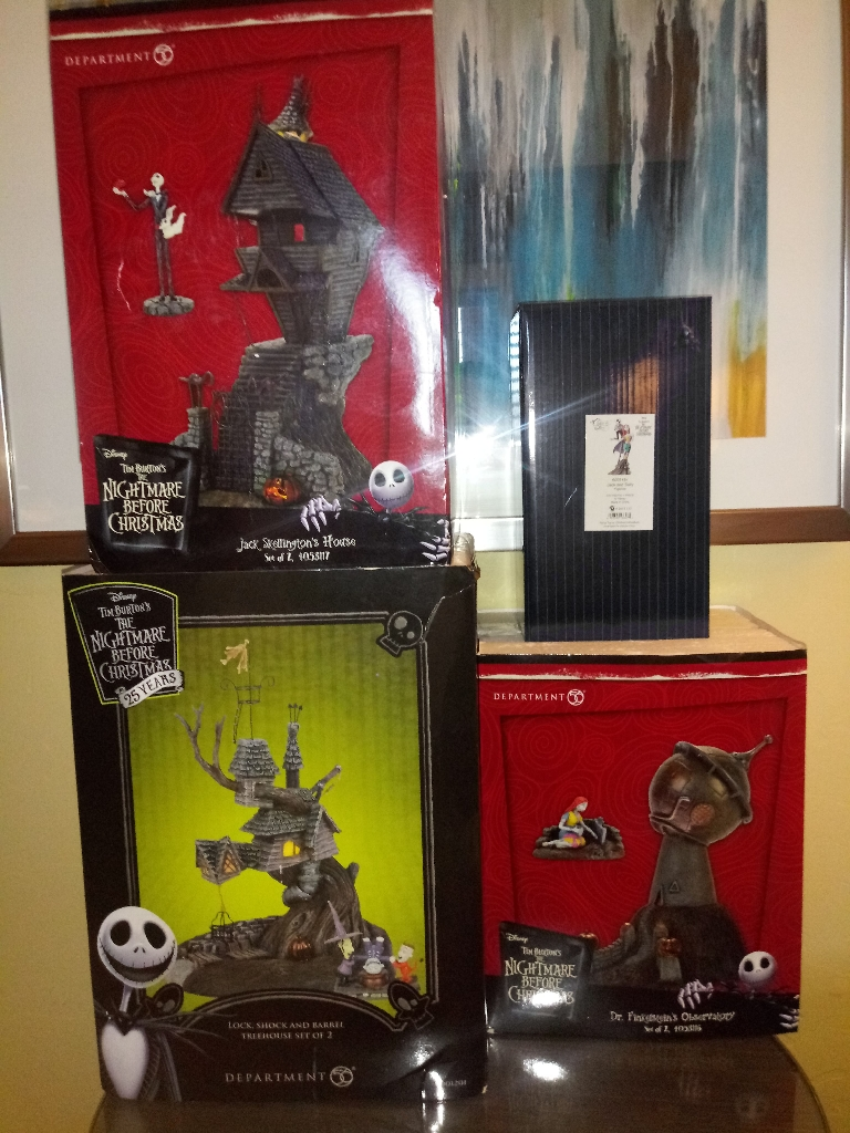"25th Anniversary "" Nightmare Before Christmas box set and figurine. 4 in all.."