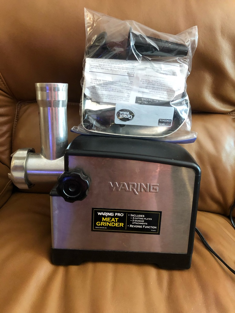 Meat grinder made by Waring.