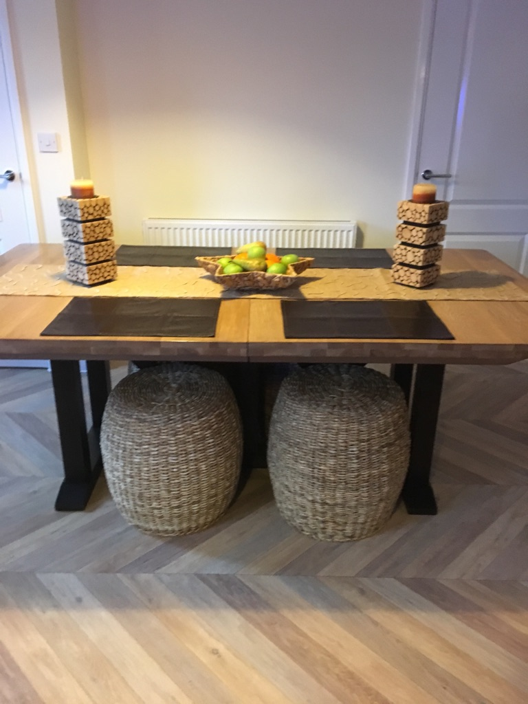 Large solid oak extendable table and 8 oversized wicker/ leather effect chairs