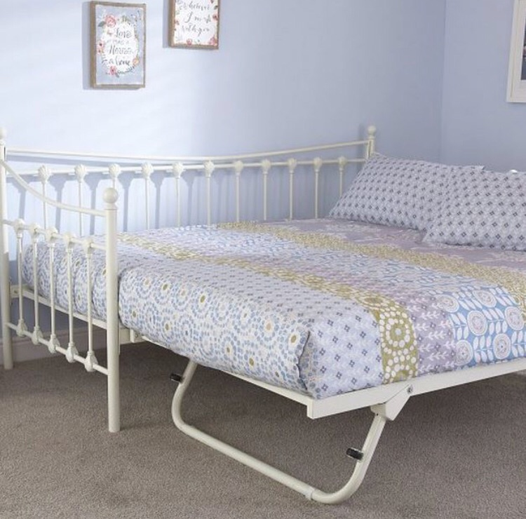 Good as new single bed with trundle + 2 single mattresses
