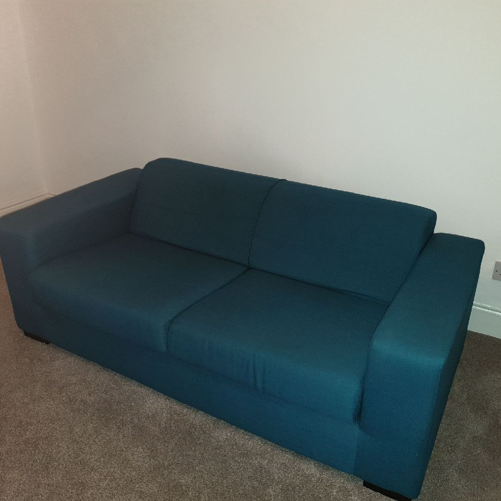 2 x 2 seater teal fabric sofas