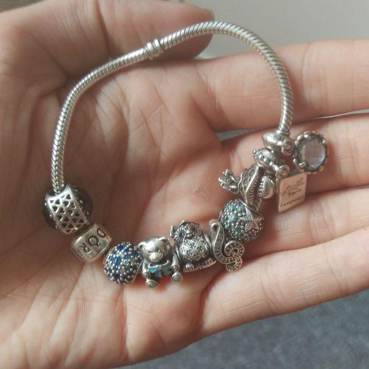 Genuine Pandora bracelet with 9 ale stamped charms RRP £300+