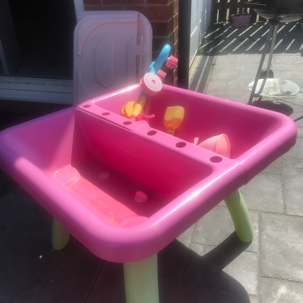 Sandpit with toys