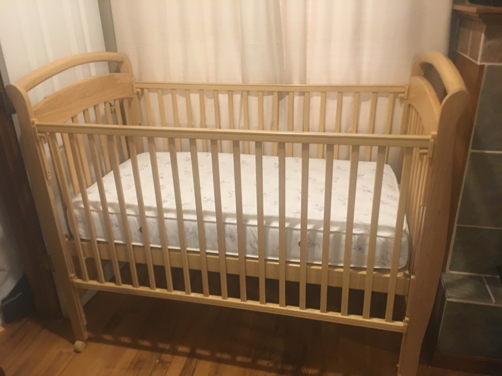 Natural wood crib with mattress