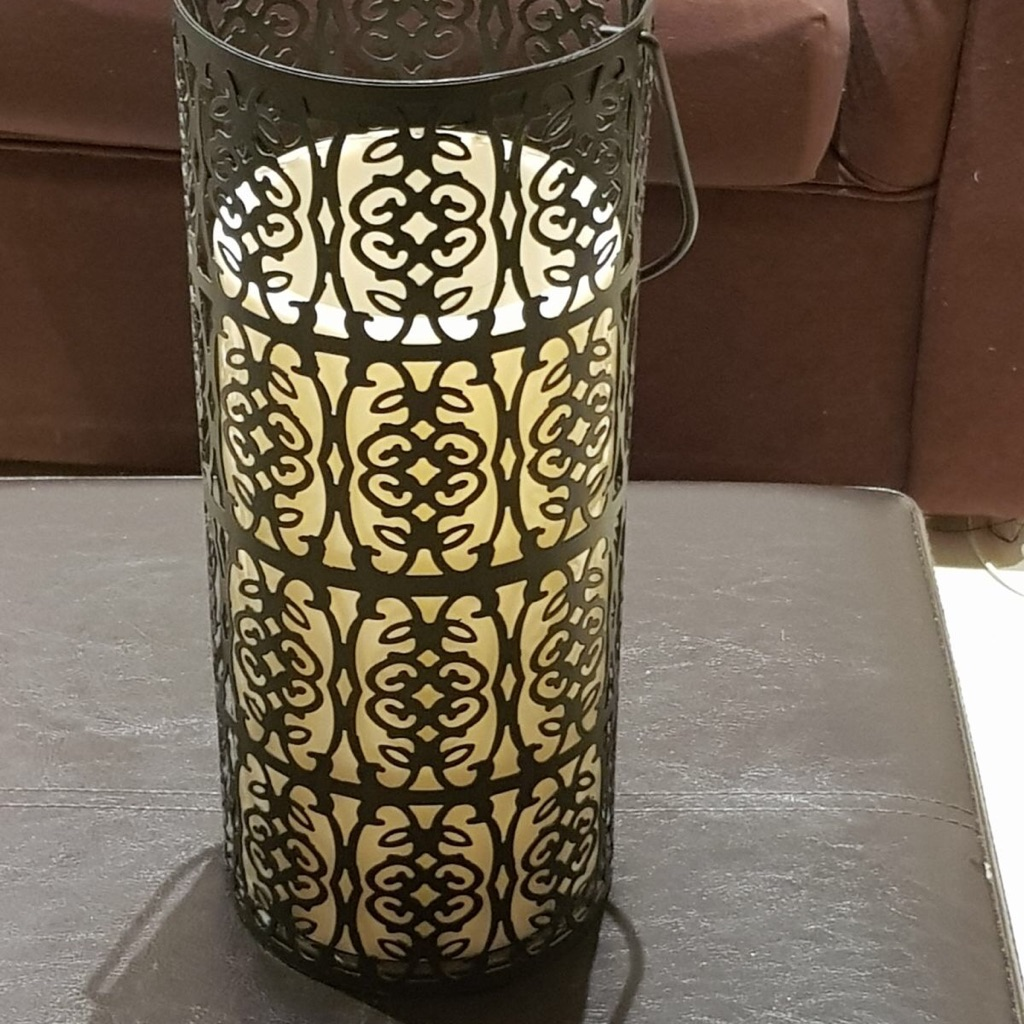 Battery operated candle in an intricate design holder