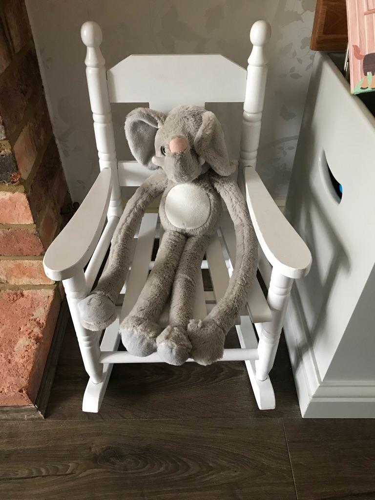Wooden children's rocking chair.