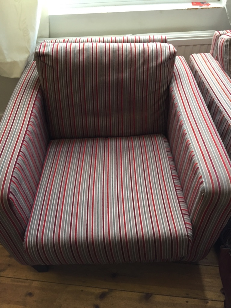 Two matching stripey chairs from next