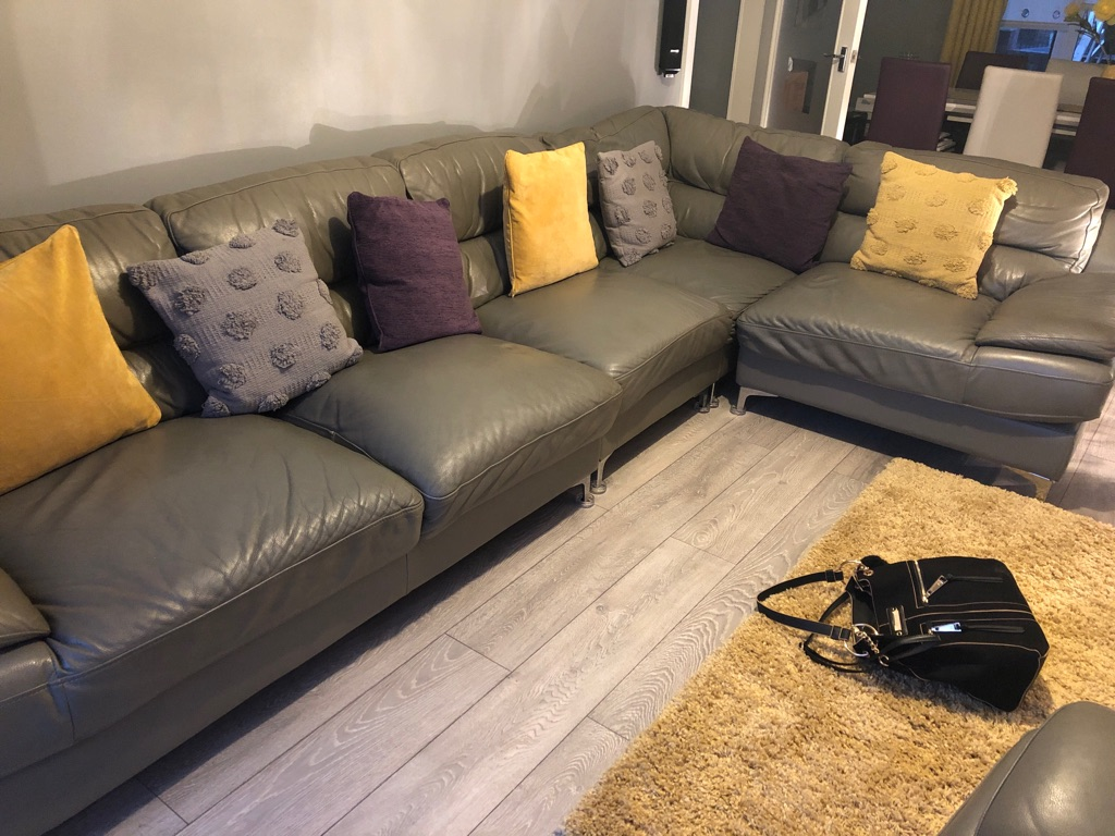Large grey corner suite with chair
