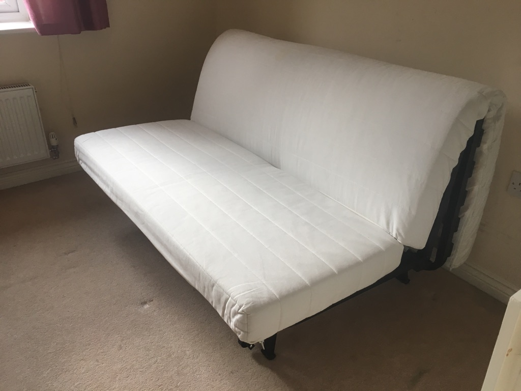 IKEA sofa bed with mattress and black cover