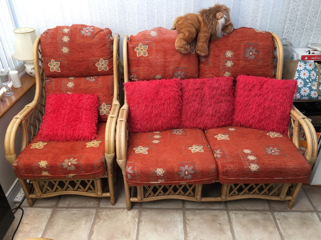 Wicker settee two chairs and table