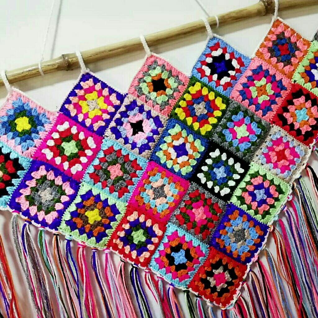 Multicolor crochet triangular wall hanging with tassels