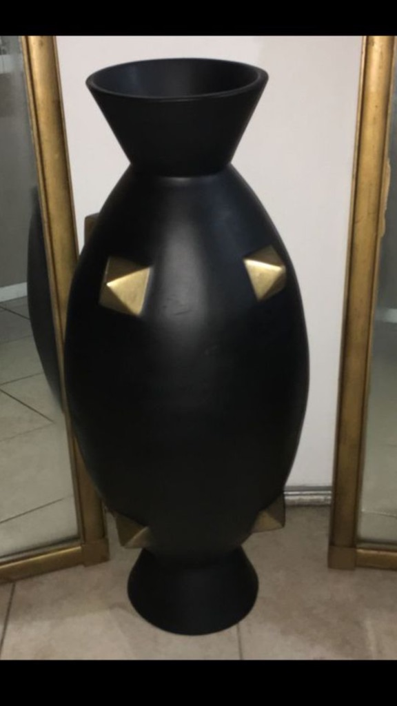 Big modern floor vase with black and gold spikes