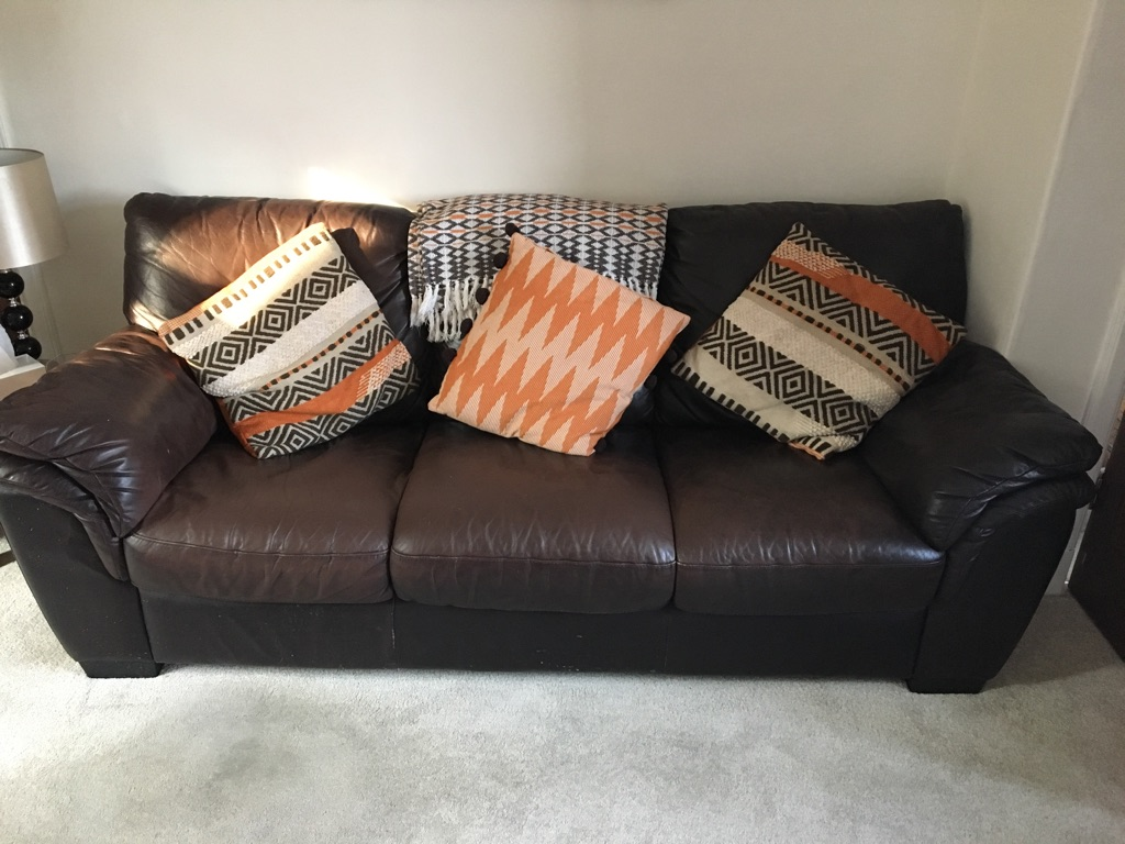 Three seater leather sofa, armchair and poof.