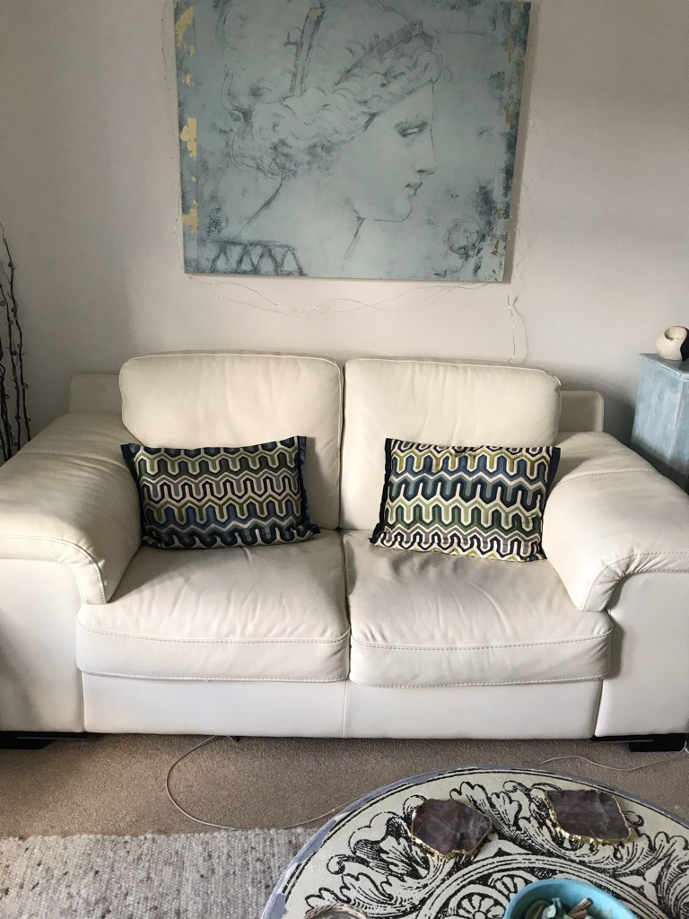 Free white/cream leather sofa