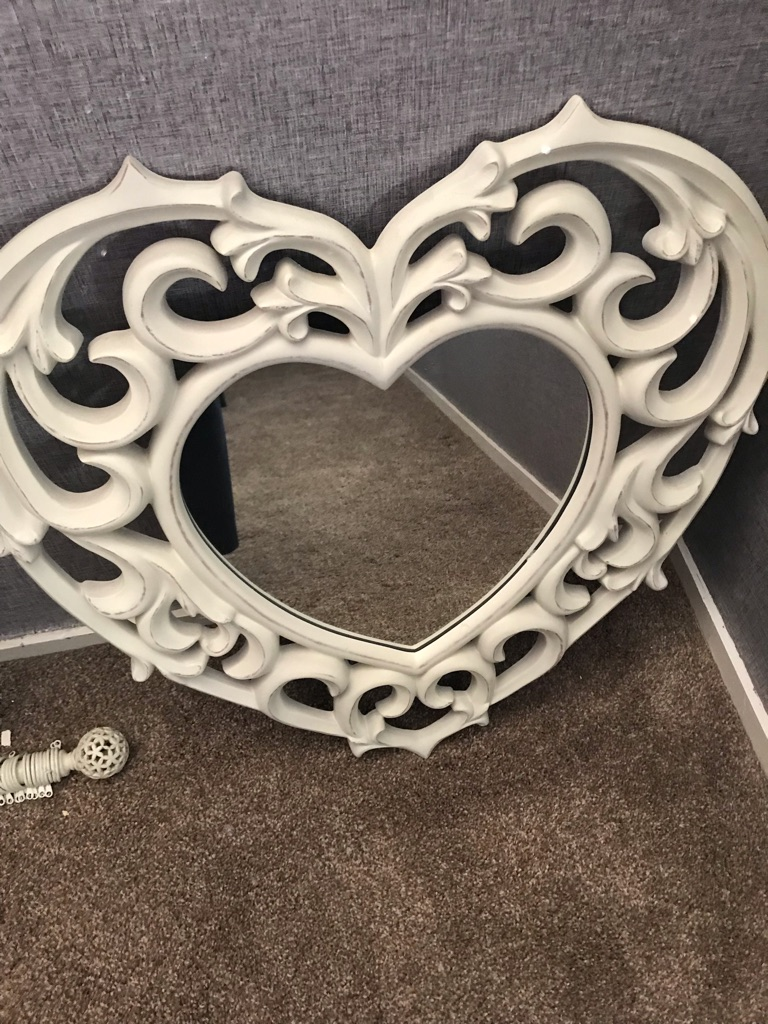 Vintage distressed heart shaped mirror