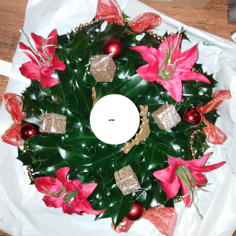 Fresh holly table centre pieces
