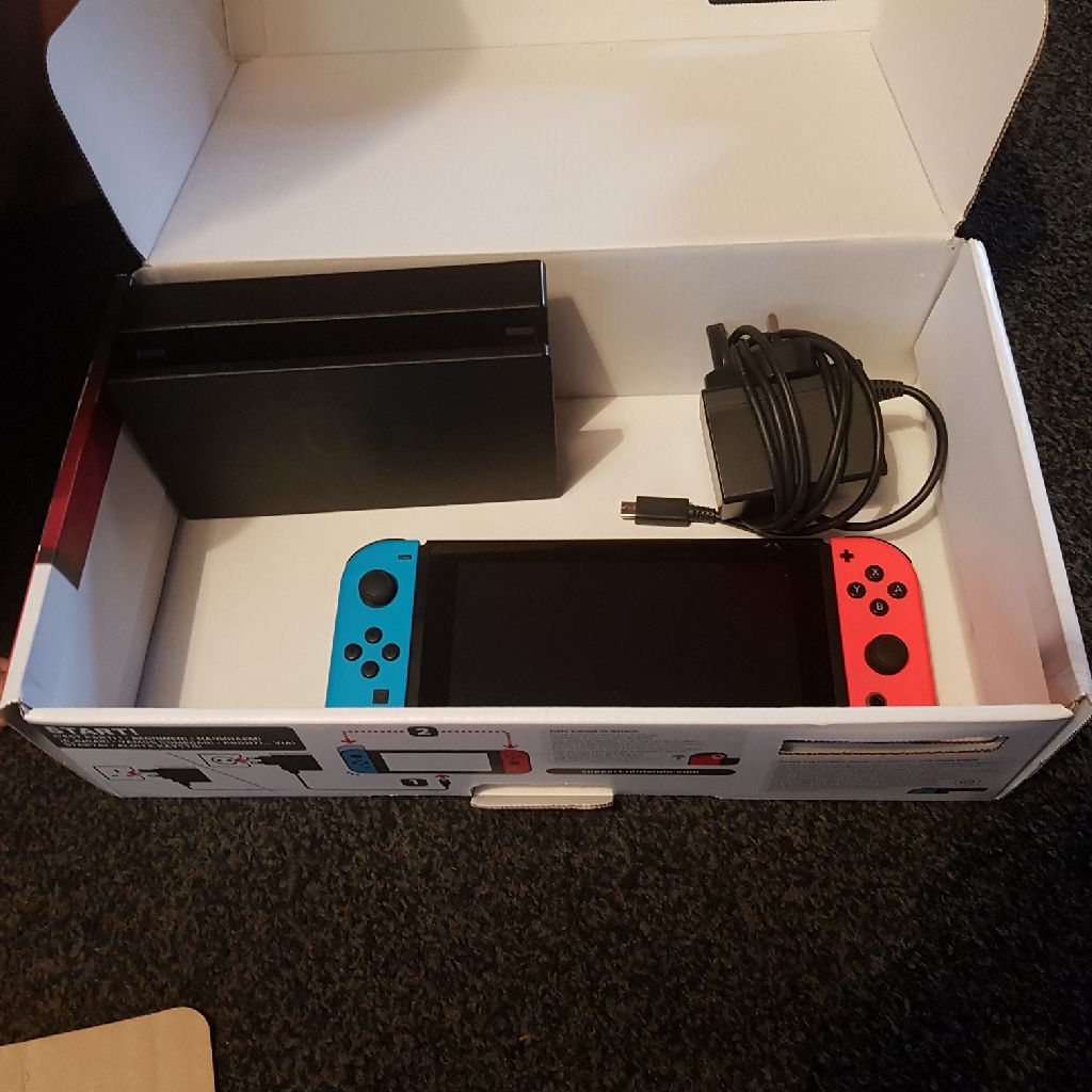 Nintendo Switch console with dock and charger