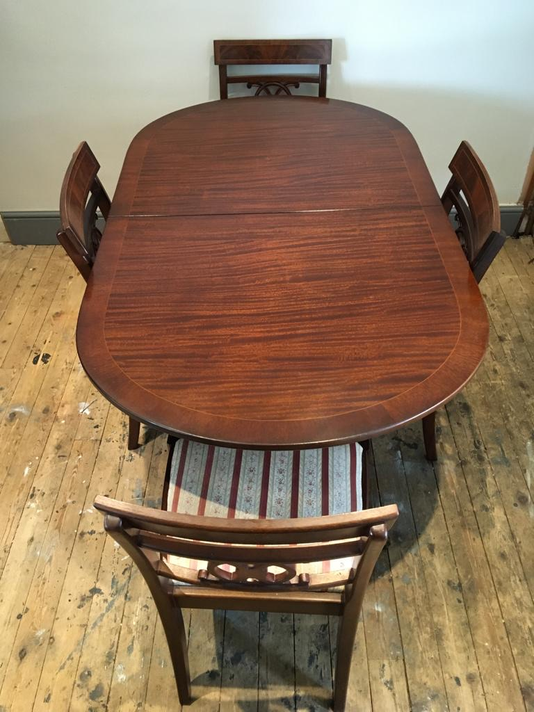 Polished mahogany extending dining table & 4 chairs