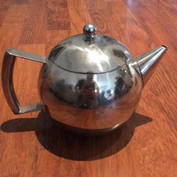 Silver teapot with filter